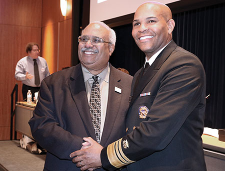 Georges Benjamin and Jerome Adams smiling